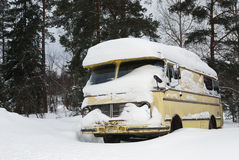 Old vinage bus covered with winter snow royalty free stock images