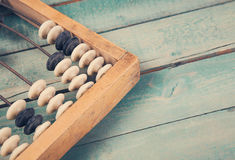 Old vintage abacus on wooden background Royalty Free Stock Image