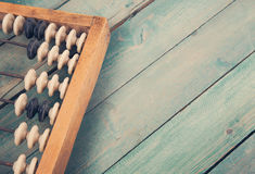 Old vintage abacus on wooden background Stock Photo