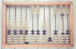 Old vintage abacus on wooden background Stock Images