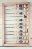 Old vintage abacus on wooden background Stock Image
