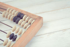 Old vintage abacus on wooden background Royalty Free Stock Photo