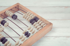 Old vintage abacus on wooden background Stock Photography