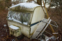Old Vintage Abandoned Camper Camping Wagon. Old Vintage Dirty Abandoned Camper Camping Wagon Caravan in a small forest stock photos