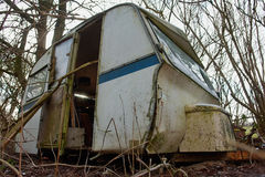 Old Vintage Abandoned Camper Camping Wagon. Old Vintage Dirty Abandoned Camper Camping Wagon Caravan in a small forest royalty free stock photography