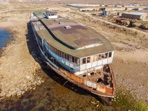 Old vintage abandoned rusted ship run aground after shipwreck accident in beginning of XX century in Crimean coast. On sand beach, aerial view from drone royalty free stock photos