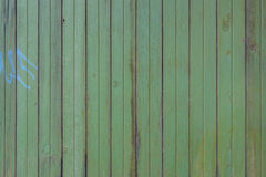 Old vintage abandoned weathered green fence texture wood backgro Royalty Free Stock Photos