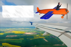 The old vintage airplane with banner ribbon Stock Image