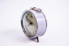 Old vintage alarm clock on white background Royalty Free Stock Image