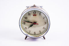 Old vintage alarm clock on white background Royalty Free Stock Photo
