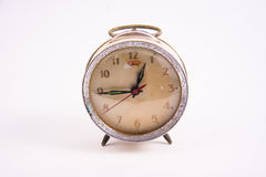 Old vintage alarm clock on white background Stock Photography