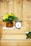 Old vintage alarm clock on wooden background Stock Photo