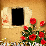 Old vintage album for photos with a bouquet of red roses and tul Royalty Free Stock Images