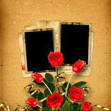 Old vintage album for photos with a bouquet of red roses Stock Photo