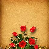 Old vintage album for photos with a bouquet of red roses Stock Image