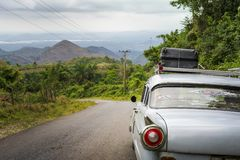Old vintage American car on a road outside Trinidad royalty free stock photo