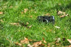 Old vintage analog rangefinder photo camera in nature autumn gra Royalty Free Stock Photos