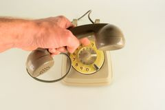 Old vintage analogic telephone. In white background Royalty Free Stock Image