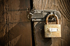 Old vintage antique padlock on wooden door Royalty Free Stock Photography