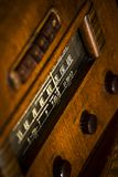 Old, vintage antique 1930`s stand-up radio with knobs and dials. Old, vintage antique stand-up radio 1930`s, warm wood tone, dials and push-buttons, warm, wood Stock Image