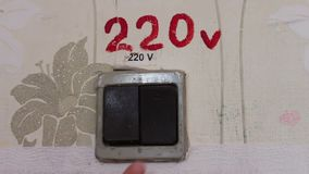 Old vintage antique turned off 220 volts which the female hand turns off and turns on.Sequence of switches stock footage