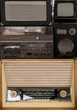 Old vintage audio system with radio, cassette tape recorder. Record player, TV set, acoustic speakers stock image