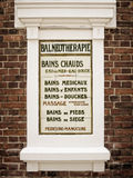 Old vintage balneotherapy french sign on ceramic tiles Stock Photos