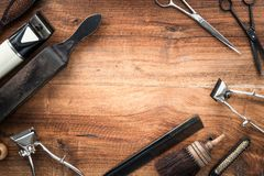 Old vintage barbershop tools on wooden table. Barbershop background with copy-space.  - retro grooming equipment royalty free stock photography