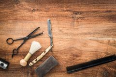 Old vintage barbershop tools on wooden table. Barbershop background with copy-space.  - retro grooming equipment royalty free stock photos