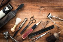 Old vintage barbershop tools on wooden table. Barbershop background with copy-space.  - retro grooming equipment stock image