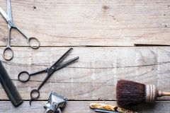 Old vintage barbershop tools on wooden table. Retro grooming equipment. Copy space stock images