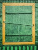 Old vintage barn wall with wooden window. Simple old window with shutters on wooden wall royalty free stock images