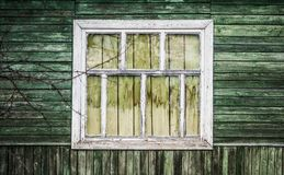 Old vintage barn wall with wooden window. Simple old window with shutters on wooden wall stock images