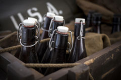 Old vintage beer bottles. Old vintage beer bottles in a wooden crate Royalty Free Stock Images