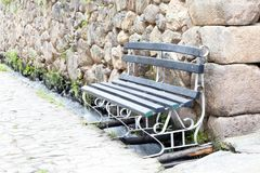 Old Vintage bench by a stone wall Stock Images