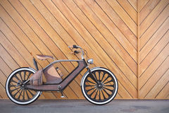 Old vintage bicycle. Steampunk style. Near the wall. 3d render Royalty Free Stock Photos