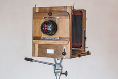 Old vintage big studio camera made of wood and metal on white background close up Royalty Free Stock Photography