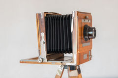Old vintage big studio camera made of wood and metal on white background close up Royalty Free Stock Photo
