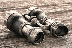 Old Vintage Binoculars on Antique Aged Wood Board Stock Image