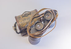 Old vintage Binoculars with treasure. Black background. Close up. Royalty Free Stock Photography