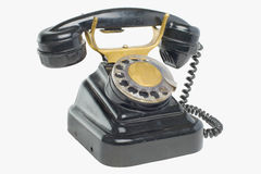Old vintage black phone with disc dials Stock Image