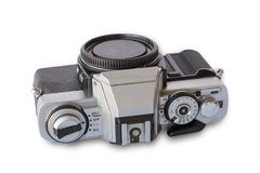 Old vintage black and silver camera. On white background, isolated Royalty Free Stock Image
