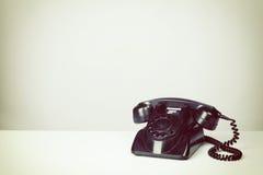 Old Vintage Black Telephone. Vintage filter added Royalty Free Stock Images