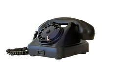 Old vintage black telephone, isolated on white background. Old vintage black telephone, isolated on white Stock Images