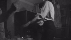 Old vintage black and white film friends have party dancing in living room