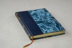 Old Vintage blue book with bookmark Stock Images
