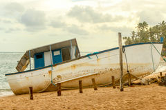 Old vintage blue and white boat on the shore of a tropical beach Royalty Free Stock Photography