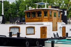 Old vintage boat on the Amsterdam canal Royalty Free Stock Image