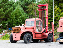 Old Vintage Boat Lift Truck. A really old, aged and worn red boat lifting truck at a dry dock / wharf royalty free stock photos