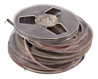 Old vintage bobbins with magnetic tapes on a white Royalty Free Stock Photo